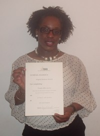 Happy Simply Afro Student receiving certificate 2012